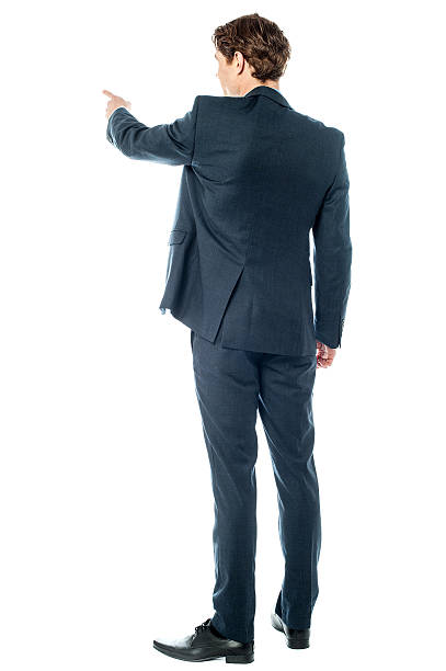 Businessman pointing at something stock photo
