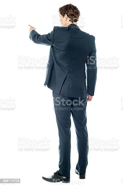 Businessman Pointing At Something Stock Photo - Download Image Now