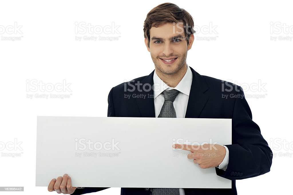 Businessman pointing at the placard royalty-free stock photo