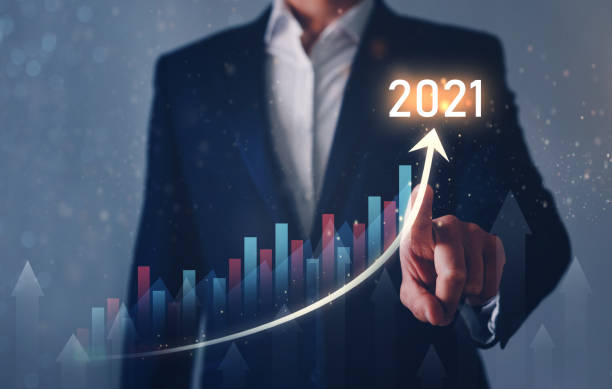 Businessman pointing digital graph company with business increase in 2021 year. Development to success and growing growth concept. stock photo