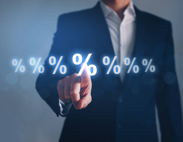 Businessman pointing digital percentage symbol. Interest rate financial and mortgage rates. stock photo