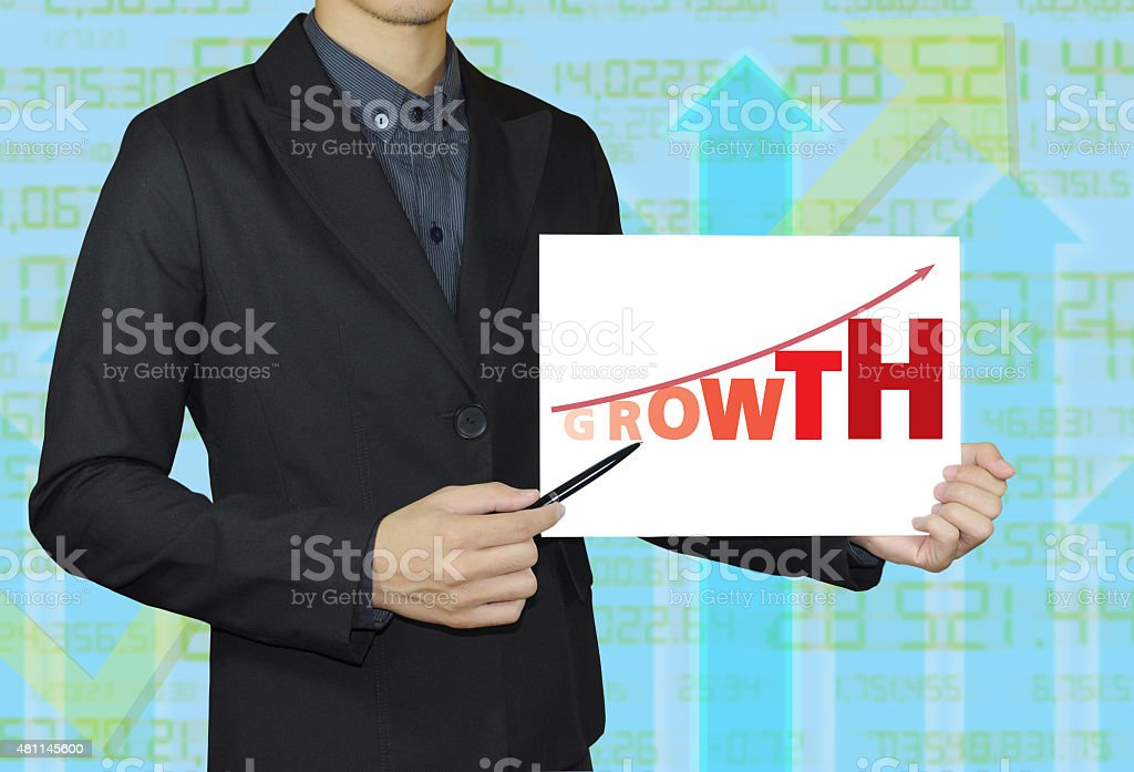 Businessman pointing document graph growth. stock photo