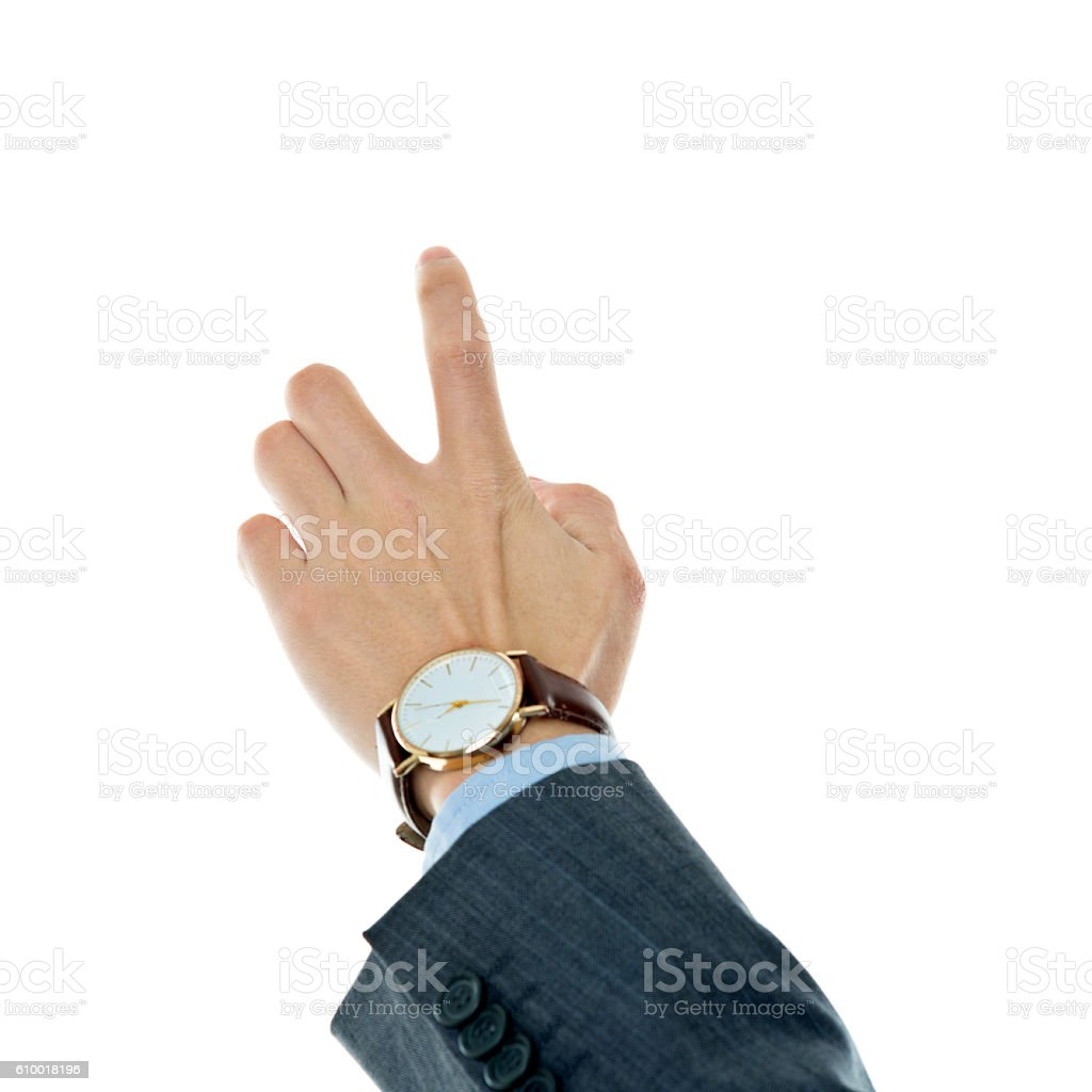 Businessman pointing finger against white background stock photo