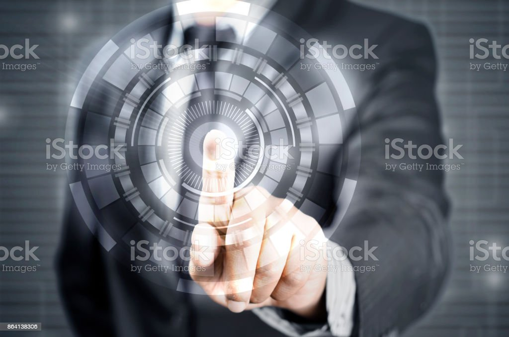 Businessman pointing finger on tech circle royalty-free stock photo