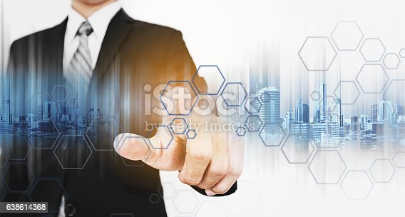 635942136istockphoto Businessman pointing finger to screen, with technology graphic 638614368