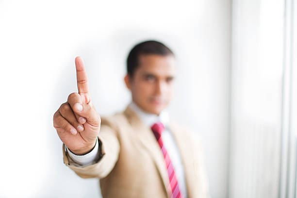 businessman pointing finger up - number 1 stock pictures, royalty-free photos & images