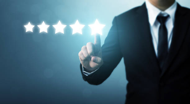 Businessman pointing five star symbol to increase rating of company - foto stock