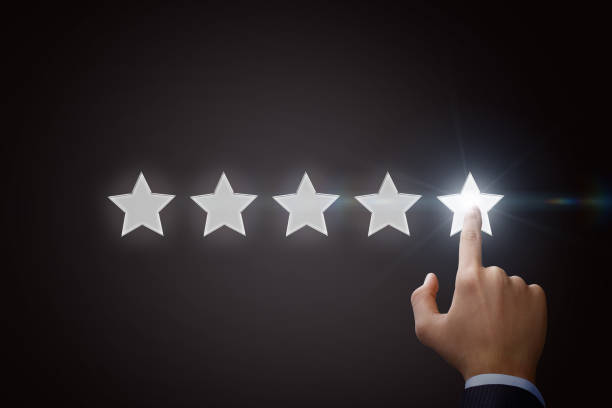 Businessman pointing five star to increase the rating. stock photo