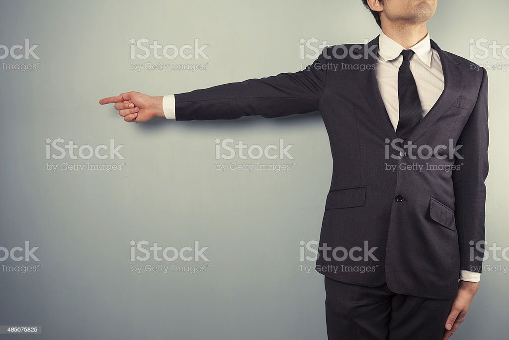 Businessman pointing left stock photo