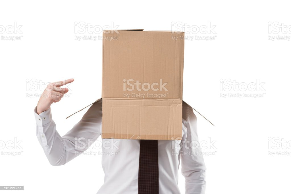 businessman pointing on cardboard box stock photo