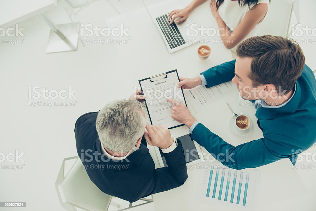 businessman pointing on one of the conditions of contract - foto stock