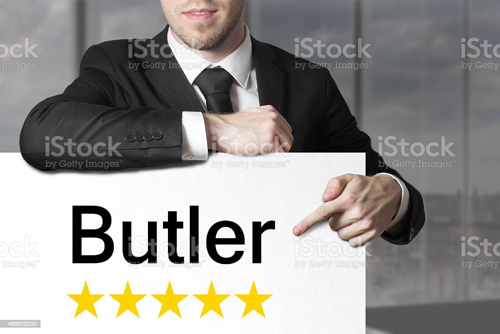 businessman pointing on sign butler five stars stock photo