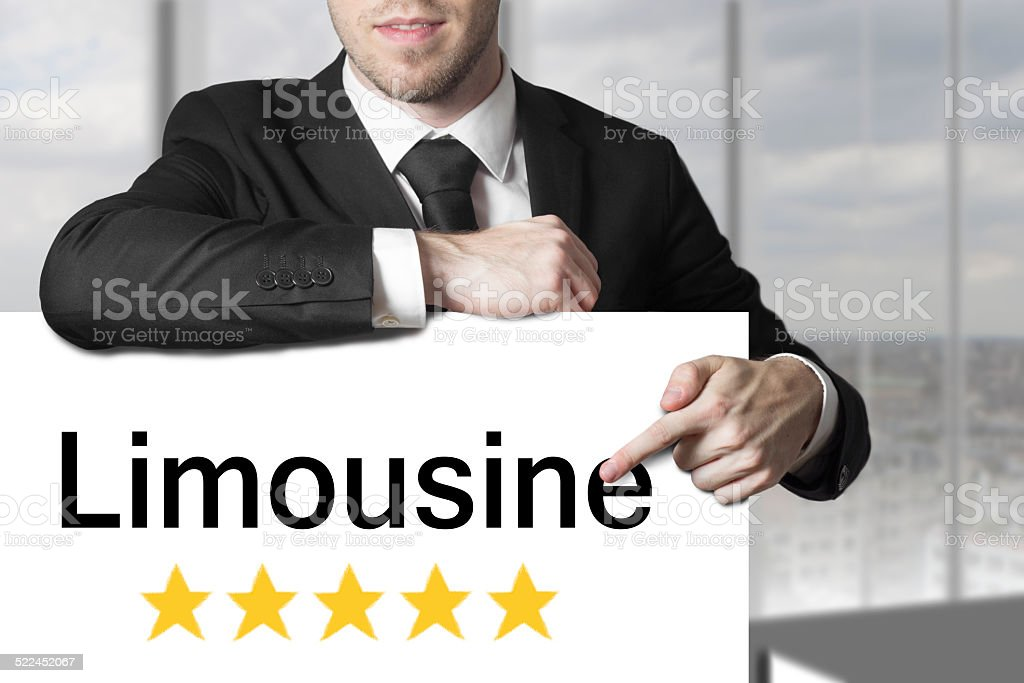 businessman pointing on sign limousine five stars stock photo