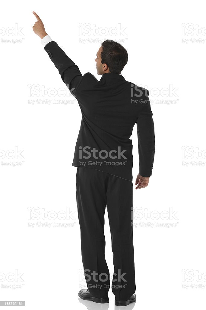 Businessman pointing rear view stock photo