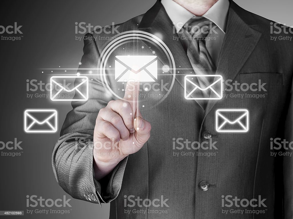 Businessman pointing shinny email concept with his fingers stock photo