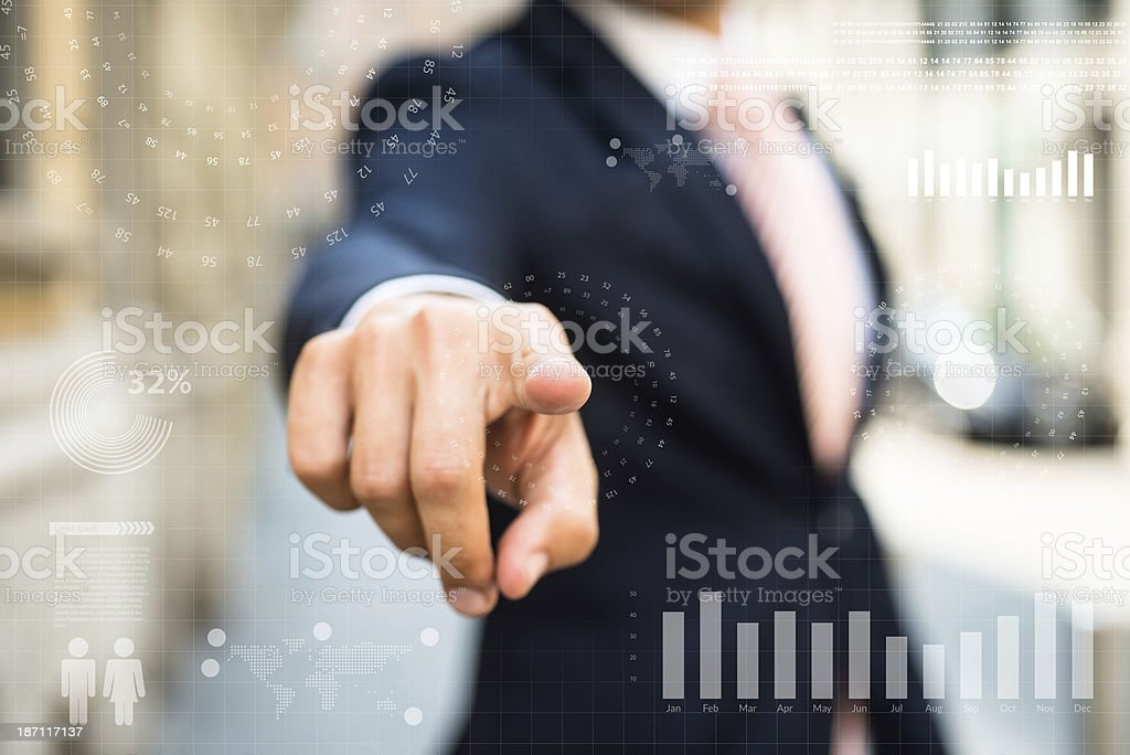 Businessman Pointing some infographics elements royalty-free stock photo