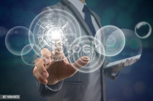 istock Businessman pointing the modern virtual screen over the photo blurred background, business and technology concept 821694920