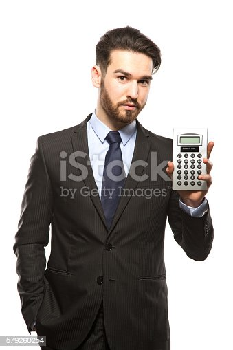 istock businessman pointing to calculator on white background 579260254