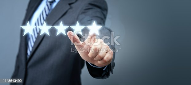 istock Businessman pointing to five star service rating symbol 1148643490
