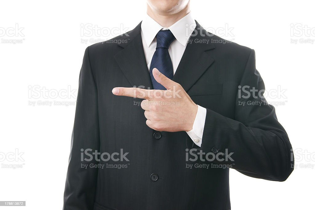 Businessman pointing to the right stock photo