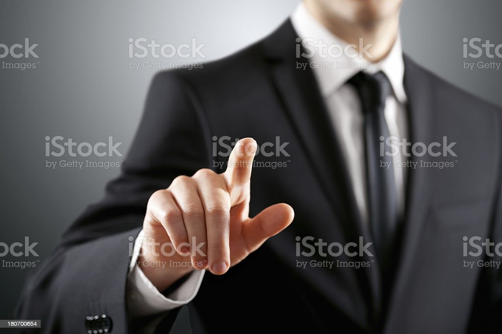 A businessman pointing towards the camera royalty-free stock photo