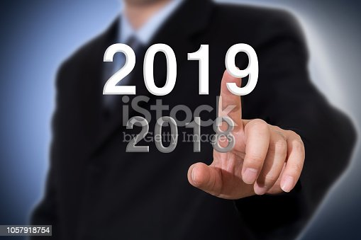 istock Businessman pointing year 2019. Businessman new year concept. 1057918754