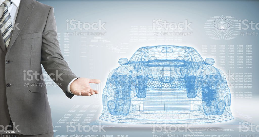 Businessman points hand on wire frame car stock photo