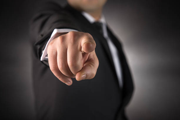 businessman points his finger at you - finger point stock photos and pictures
