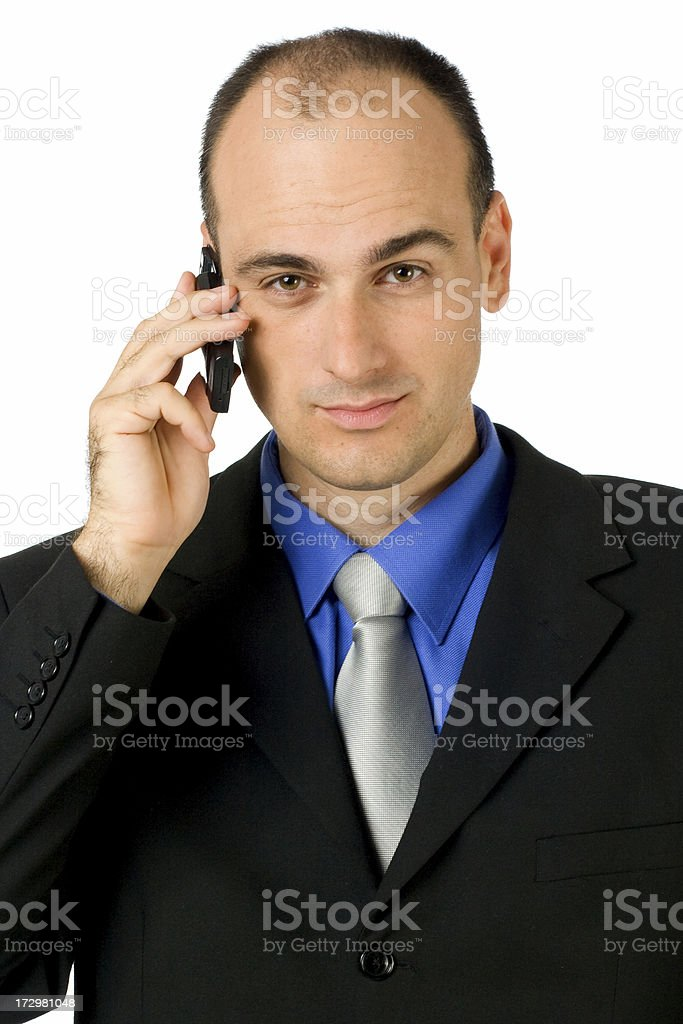 Businessman portrait holding phone royalty-free stock photo
