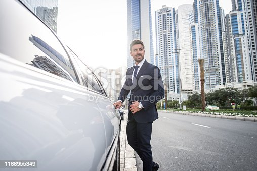 Handsome caucasian businessman - Portrait of a businessman walking outdoors