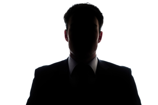 Businessman portrait silhouette and a mysterious face
