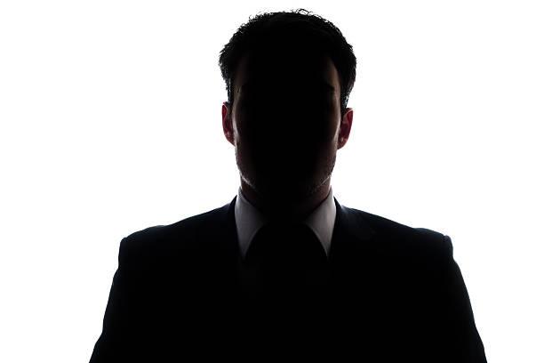 geschäftsmann porträt silhouette und einer geheimnisvollen gesicht - gegenlicht stock-fotos und bilder