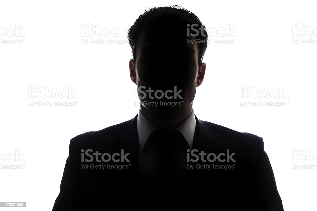 Businessman portrait silhouette and a mysterious face stock photo
