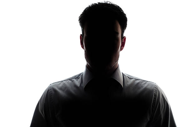 Businessman portrait silhouette wearing a shirt and tie stock photo