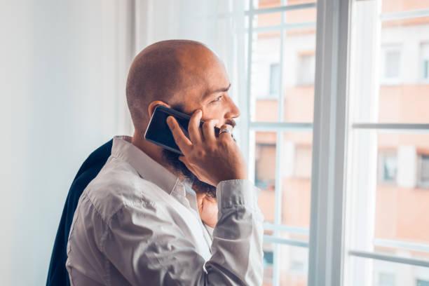 Businessman portrait with cellphone. stock photo