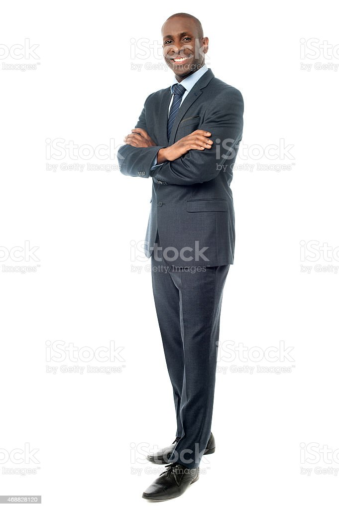 Businessman posing confidently stock photo