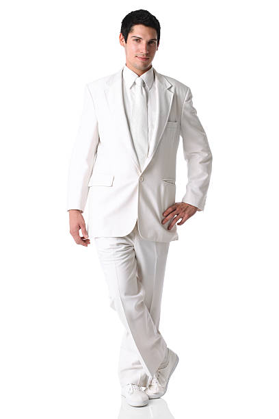 businessman posing in white suit - white suit stock photos and pictures