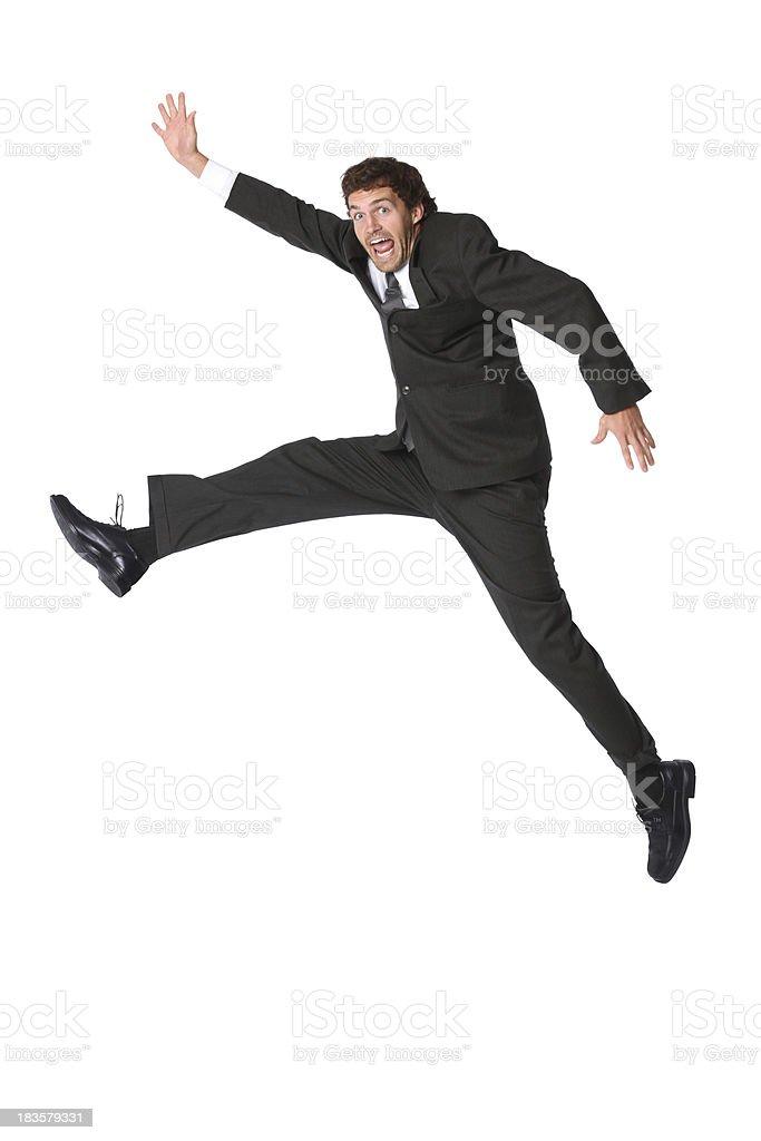 Businessman posing mid air jumping stock photo