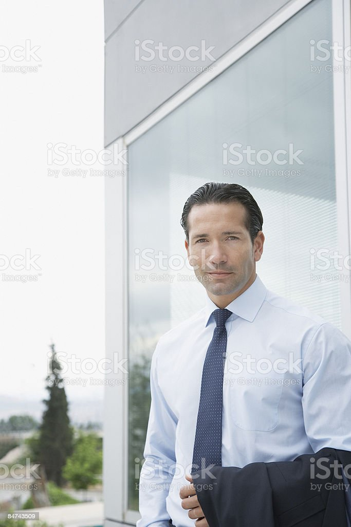 Businessman posing outdoors stock photo