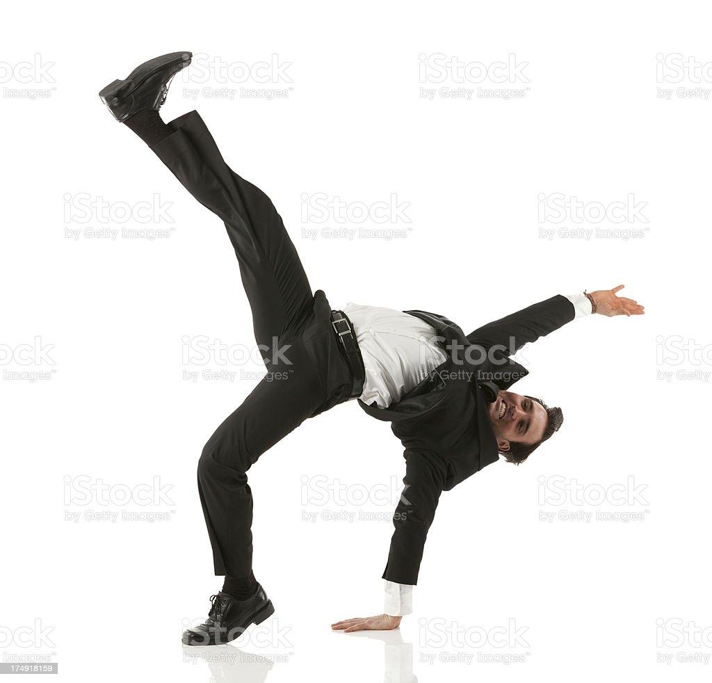 Businessman practicing martial arts stock photo