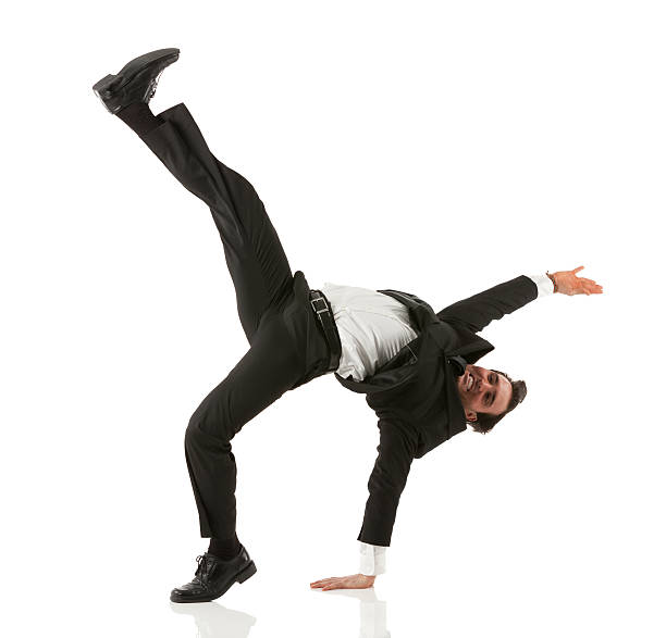 Businessman practicing martial arts Businessman practicing martial arts bending over backwards stock pictures, royalty-free photos & images