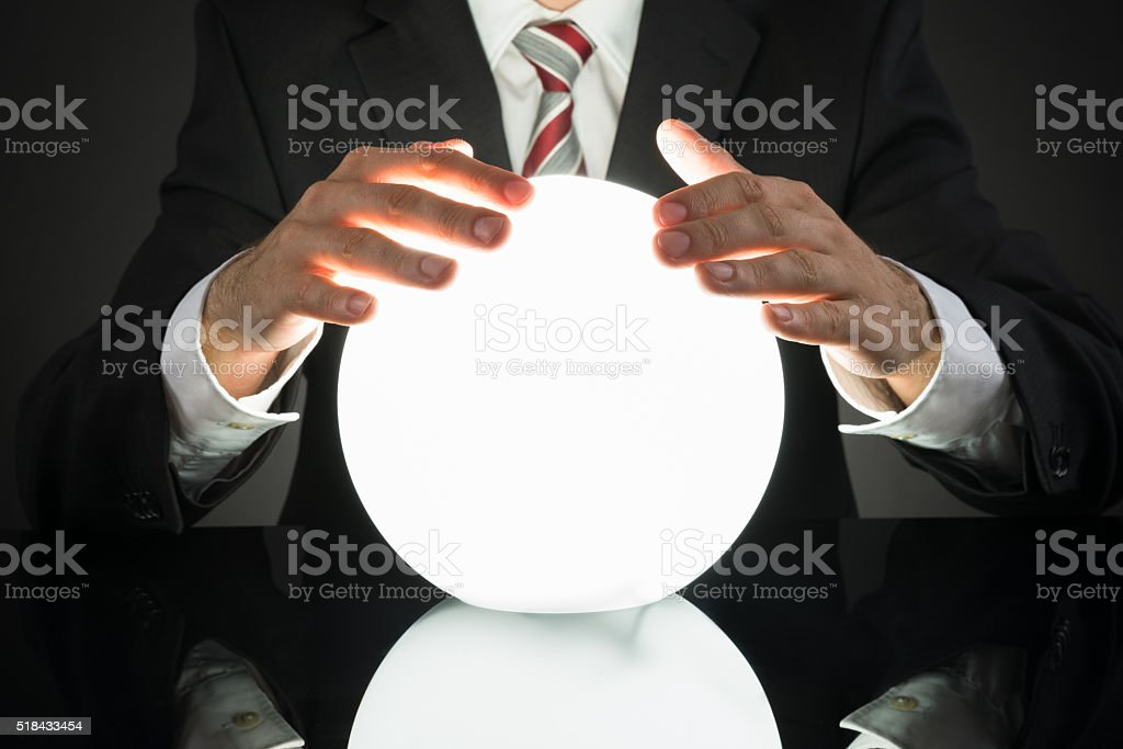 Businessman Predicting Future With Crystal Ball stock photo