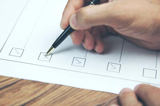 businessman preparing checklist at office desk stock photo