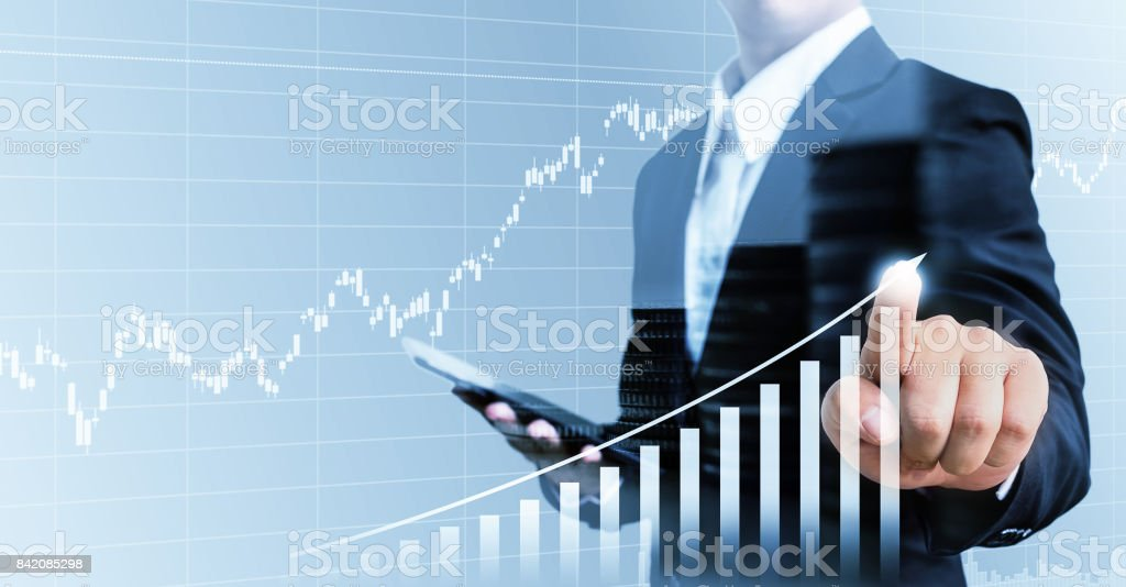Businessman present financial hand touching graph growing business,Double exposure stock photo