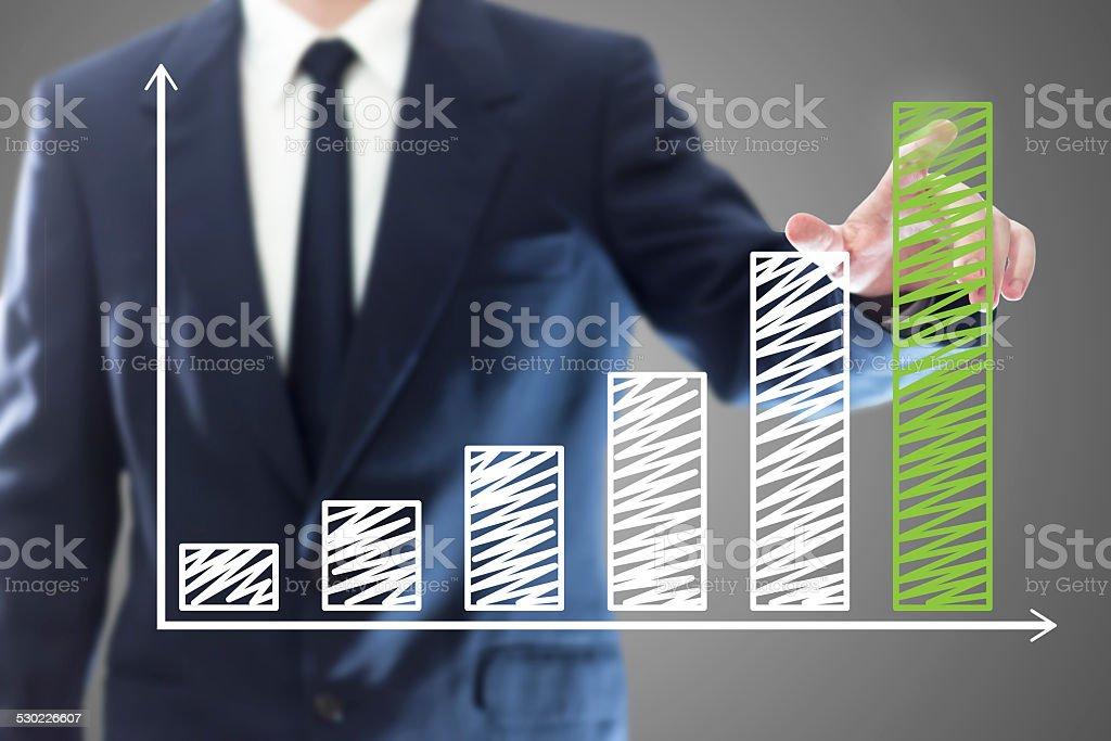 Businessman presenting a chart stock photo