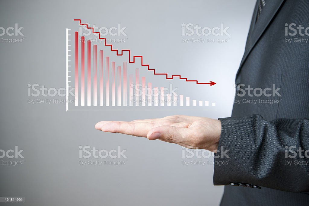Businessman presenting a sustainable decrease development stock photo