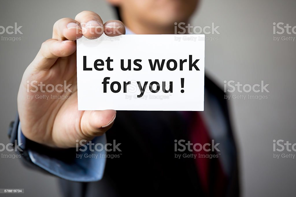 Businessman presenting 'Let us work for you'' word stock photo