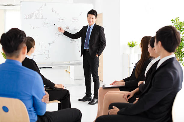 Businessman presenting new project to partners in office ストックフォト