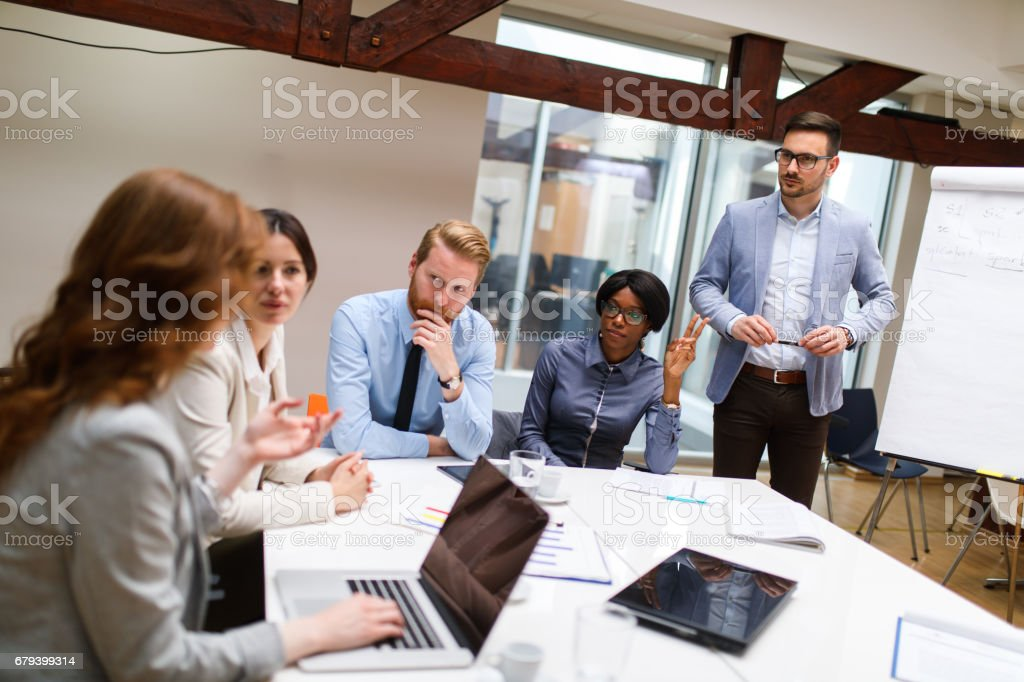 Businessman presenting new project to partners in the office. royalty-free stock photo