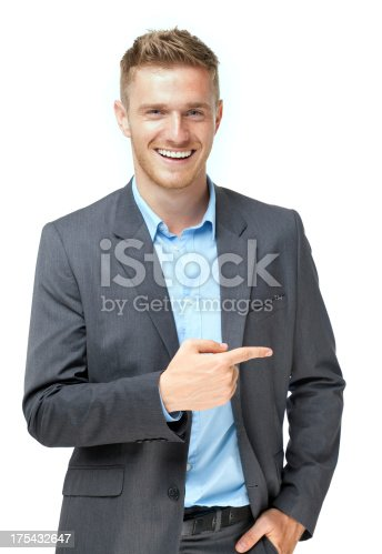 istock businessman presenting over white background 175432647